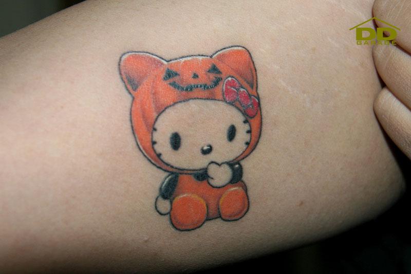 hello kitty tattoos designs. Mr. R got a Hello Kitty tattoo